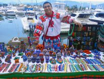 Mexican street vendor proud of his wares