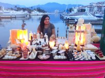 Craftswoman selling onyx lamps and trinkets